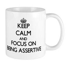 Keep Calm and focus on Being Assertive Mugs