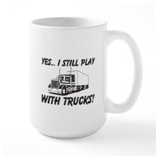 Yes I Still Play With Trucks MugMugs