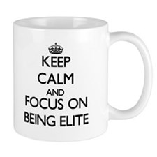 Keep Calm and focus on BEING ELITE Mugs