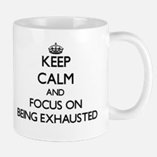 Keep Calm and focus on BEING EXHAUSTED Mugs
