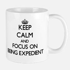Keep Calm and focus on BEING EXPEDIENT Mugs