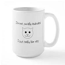 I just really like cats Mugs