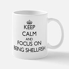 Keep Calm and focus on Being Shellfish Mugs