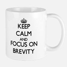 Keep Calm and focus on Brevity Mugs