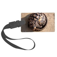 curled up pangolin Luggage Tag