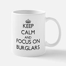 Keep Calm and focus on Burglars Mugs