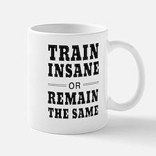 Train insane or remain same Mugs