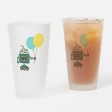 Cute Green Robot with Balloons Drinking Glass