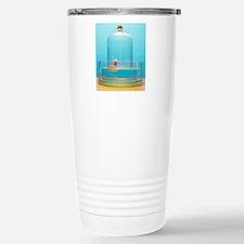 Lit candle under bell j Travel Mug