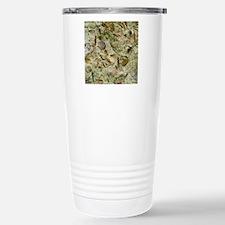 A mixed assemblage of f Travel Mug