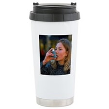 Teenager using an aeros Travel Mug