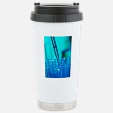 Pipette adding fluid to Travel Mug