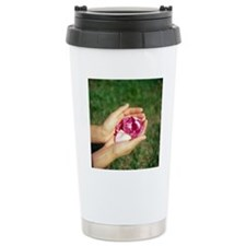 Flower held in hands Travel Coffee Mug