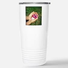 Flower held in hands Travel Mug
