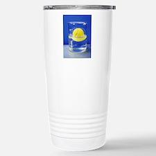 Tennis ball floating in Travel Mug