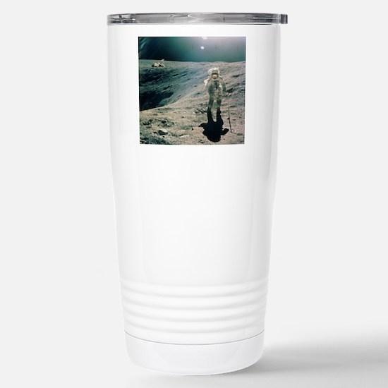 Astronaut Duke next to  Stainless Steel Travel Mug