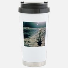 Astronaut Duke next to  Travel Mug