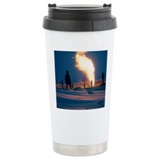 Gas flare in oil field Travel Mug