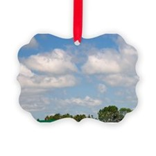 Red barn and farm house on Prince Ornament