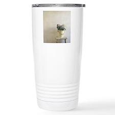A metal bucket still li Travel Mug