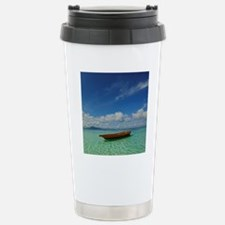 Small boat floating on  Stainless Steel Travel Mug