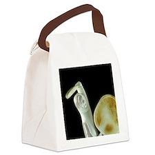 Ypical carved caribou antler figu Canvas Lunch Bag