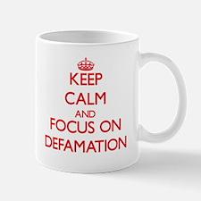 Keep Calm and focus on Defamation Mugs