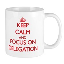 Keep Calm and focus on Delegation Mugs