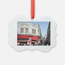 Shoppers crowd the sidewalks of B Ornament