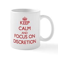 Keep Calm and focus on Discretion Mugs