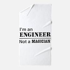 Engineer, not magician Beach Towel