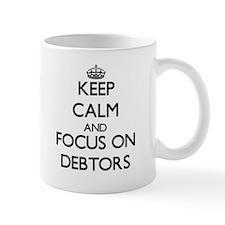 Keep Calm and focus on Debtors Mugs