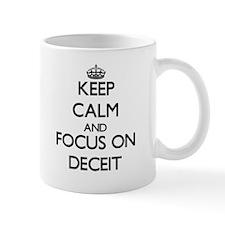 Keep Calm and focus on Deceit Mugs