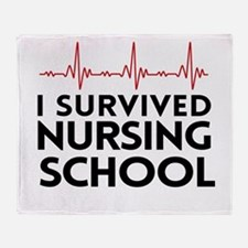 I survived nursing school Throw Blanket