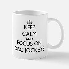 Keep Calm and focus on Disc Jockeys Mugs