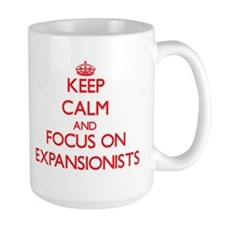 Keep Calm and focus on EXPANSIONISTS Mugs
