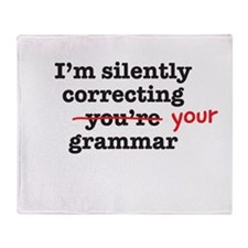 Silently correcting grammar Throw Blanket
