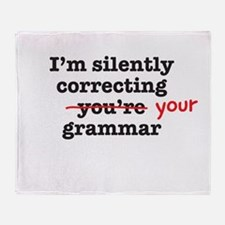 Silently correcting grammar Throw Blanket