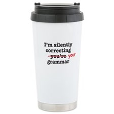 Silently correcting grammar Travel Mug