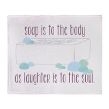 Soap is to the body Throw Blanket