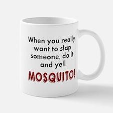 Slap someone mosquito Mug