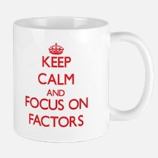 Keep Calm and focus on Factors Mugs