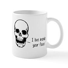 A Skull Lives Inside Your Face Mugs