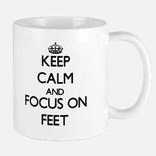 Keep Calm and focus on Feet Mugs
