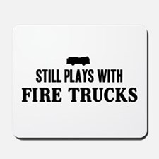 Still plays with fire trucks Mousepad