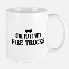 Still plays with fire trucks Mugs