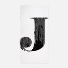Grungy letter J Beach Towel
