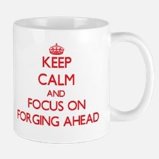 Keep Calm and focus on Forging Ahead Mugs