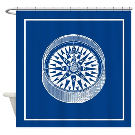 Nautical compass on blue shower curtain by scarebaby