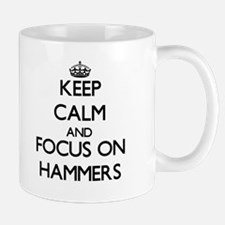 Keep Calm and focus on Hammers Mugs